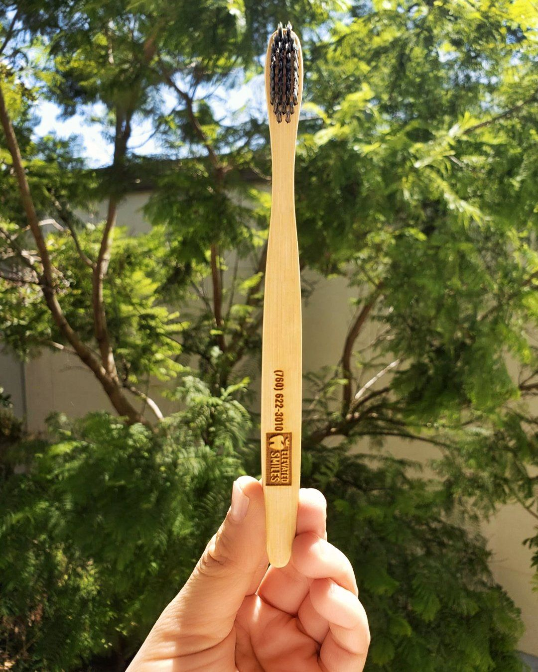 A bamboo toothbrush by Elevated Smiles in Carlsbad
