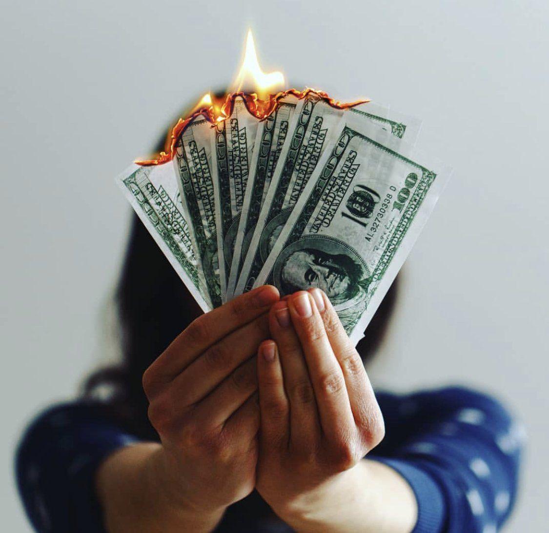 100 dollar bills on fire